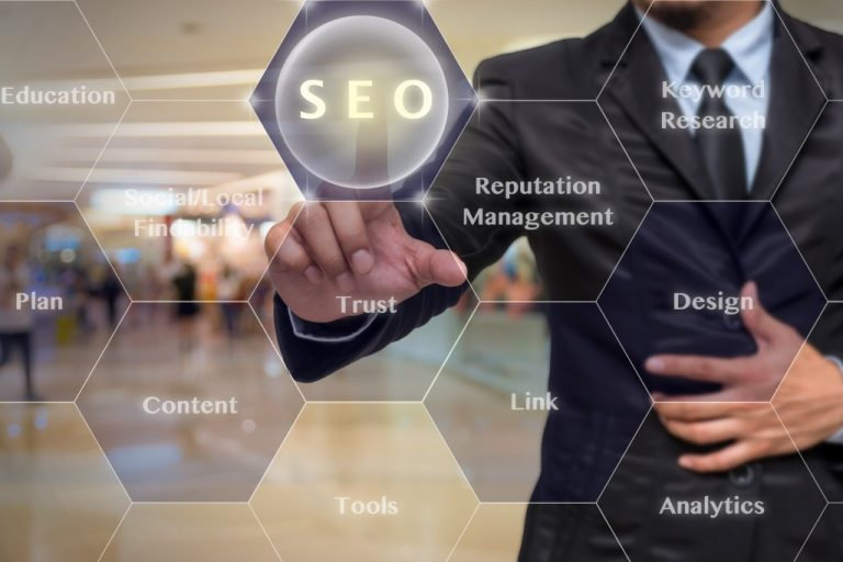 Businessman pressing SEO