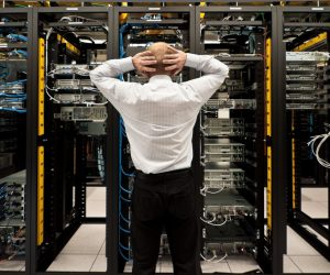 Man looking astonished in a network data center