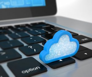 cloud miniature on top of a laptop keyboard