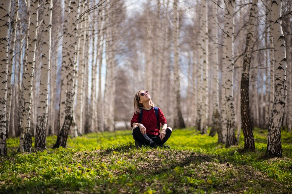 woman sitting in the woods