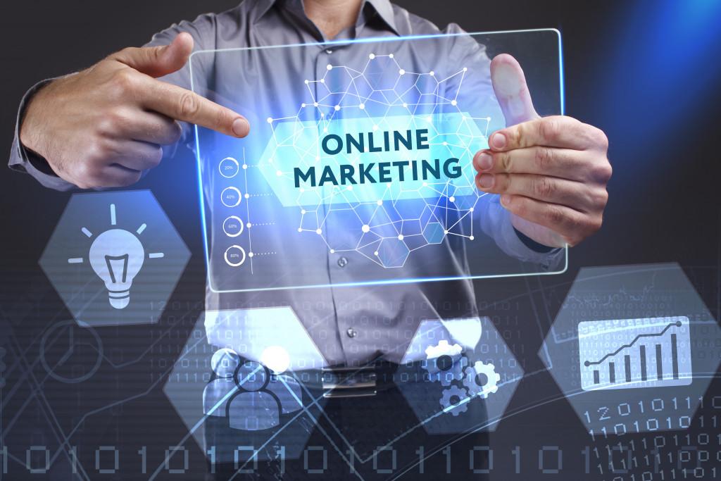 man holding online marketing plaque